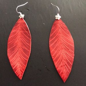 Etched leather feathers